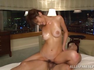 Oiled Sara Yurika gets her pussy banged wits a dude on be passed on bed
