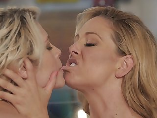 Infectious blonde is satisfying her mistress with cunnilingus