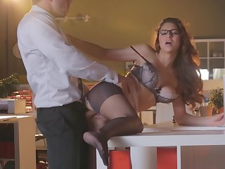 Handsome big cheese owns swanky secretary with glasses after work